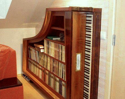 recycled piano into bookcase