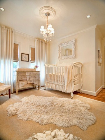 neutral baby nursery with mirrored dresser