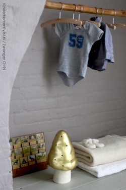 neutral baby nursery with brick wall adds texture