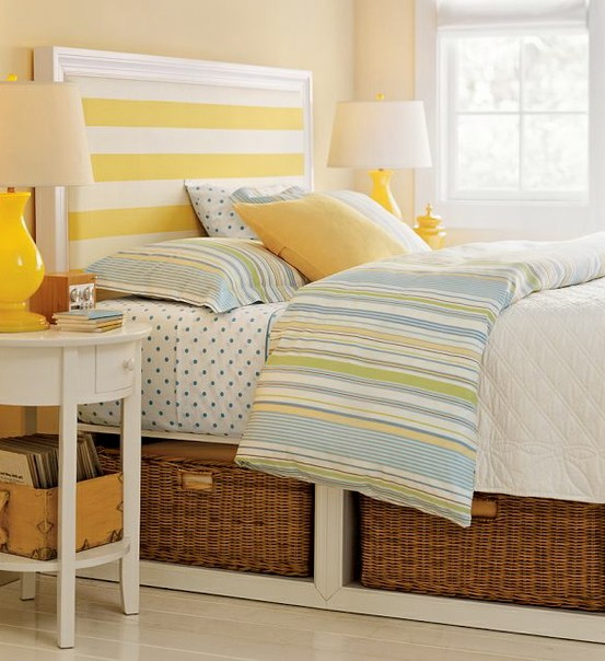 striped headboard in sunny yellow teen bedroom