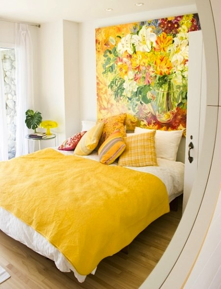 sunny yellow teen room with artwork over bed