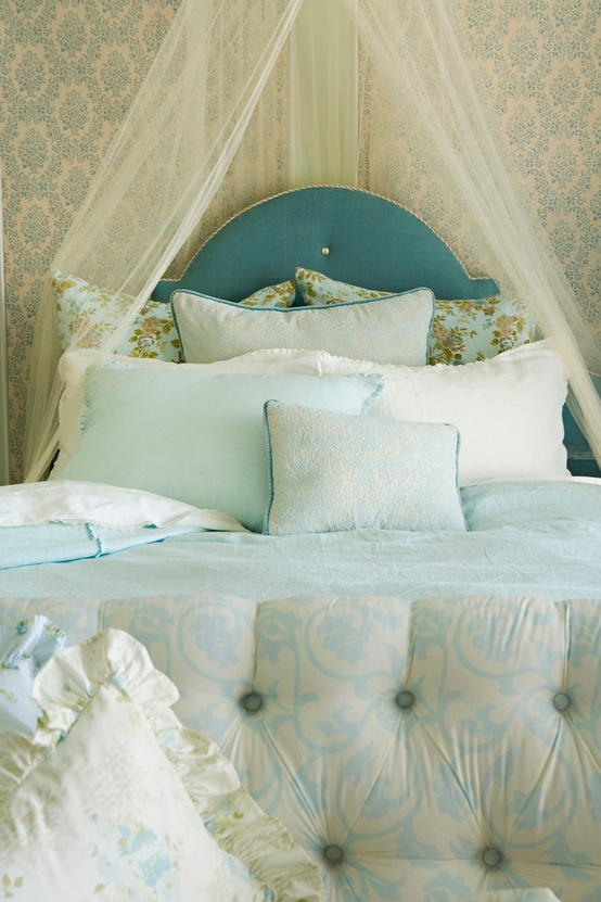 soft teal teen bedroom with upholstered headboard