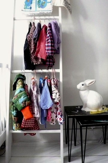 repurposed ladder for kids room clothing storage