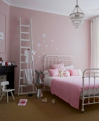 pink girls room with repurposed ladder storage
