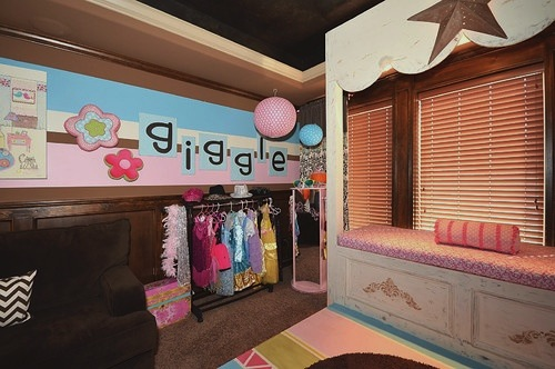 dress up clothes storage in kids play room