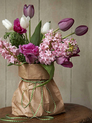 spring flowers in paper bag with twine