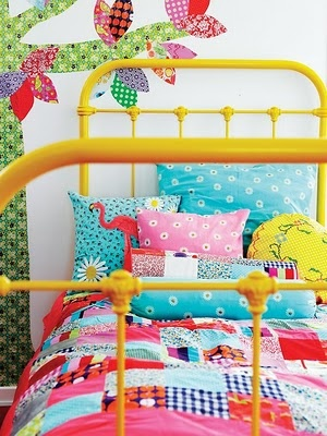 bright yellow iron bed in teen room