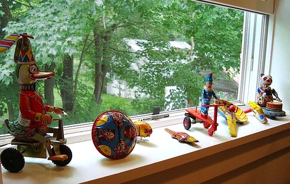 vintage toy display on window sill