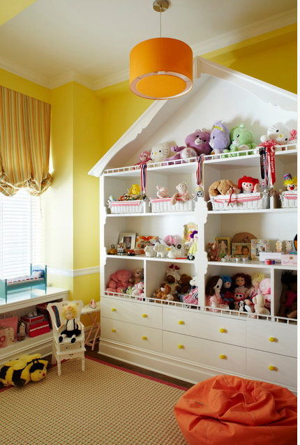 large doll collection in dollhouse bookcase