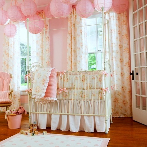 pink baby nursery with chinese lanterns ceiling decor