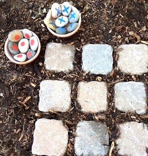 outdoor tic tac toe game with paving blocks and stones