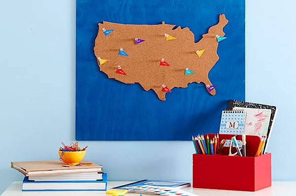 corkboard USA map with family map flags
