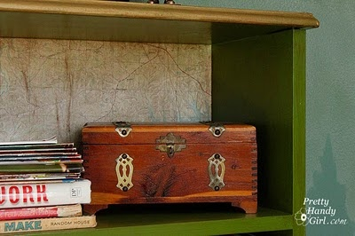 bookcase with map covered back wall