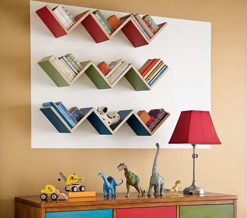 chevron shaped bookshelves on kids room wall