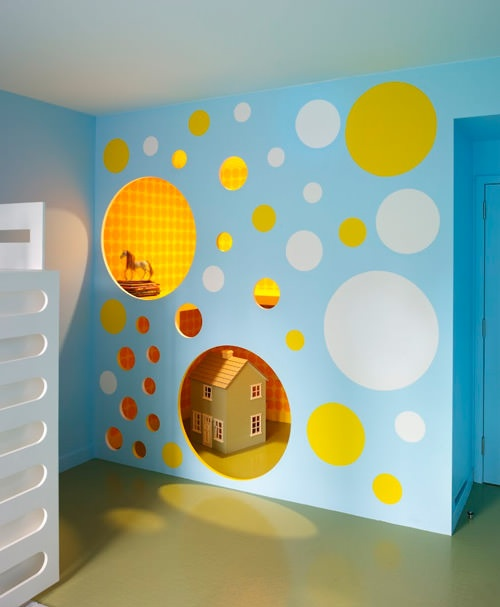 fun indoor playhouse with circle cutouts