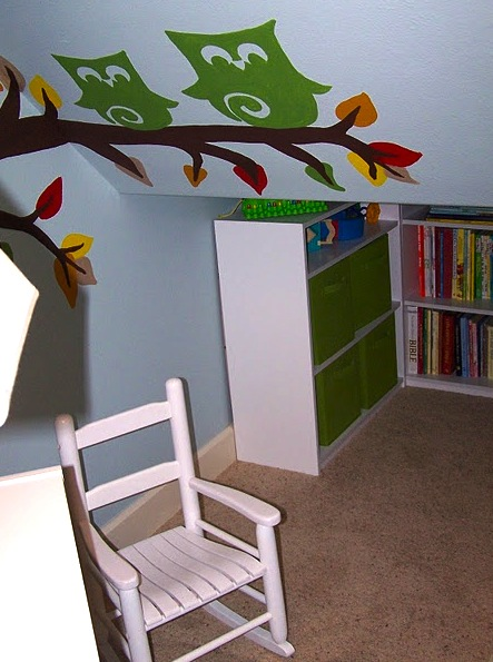 kids reading area under the stairs