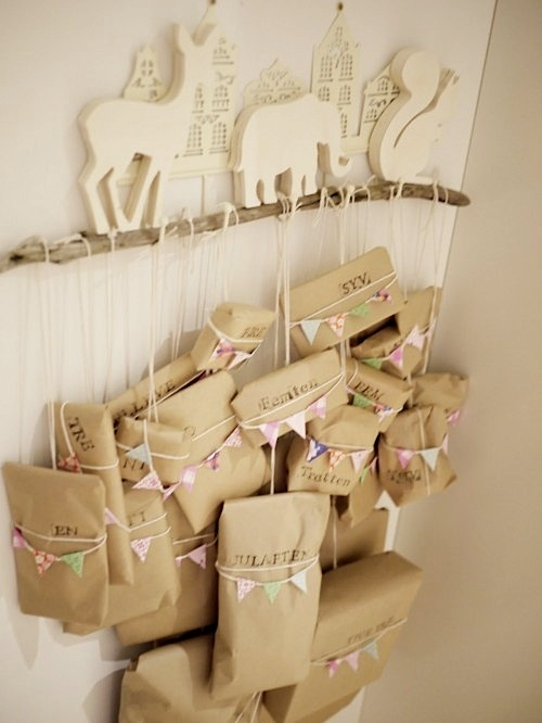 reindeer on branch holding christmas countdown gifts in kraft paper - 14 Creative Countdown To Christmas Ideas KidSpace Interiors