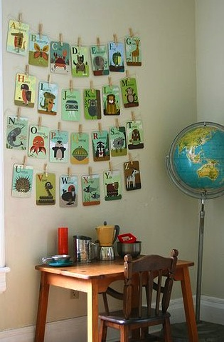 abc cards on string over toddler desk