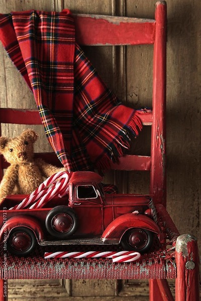 tartan plaid and toys in red chair