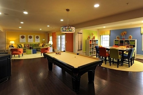 family room for teens with crafts table and storage pool table and video games